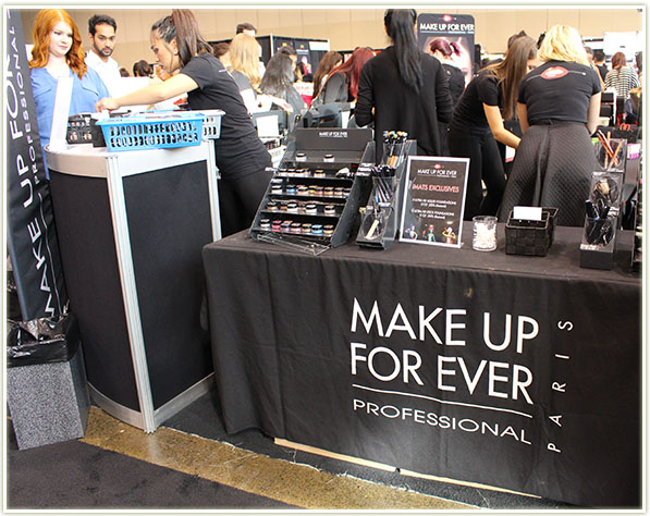Make Up For Ever booth. BTW, if that's you with the flaming orange hair in the top left corner of this shot... your hair is AMAZING!