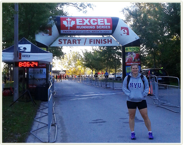 Standing in front of the Start/Finish Toronto 10 Miler